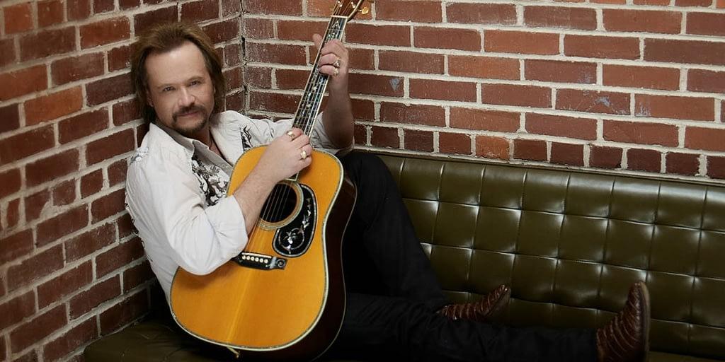 Travis Tritt Playing the guitar