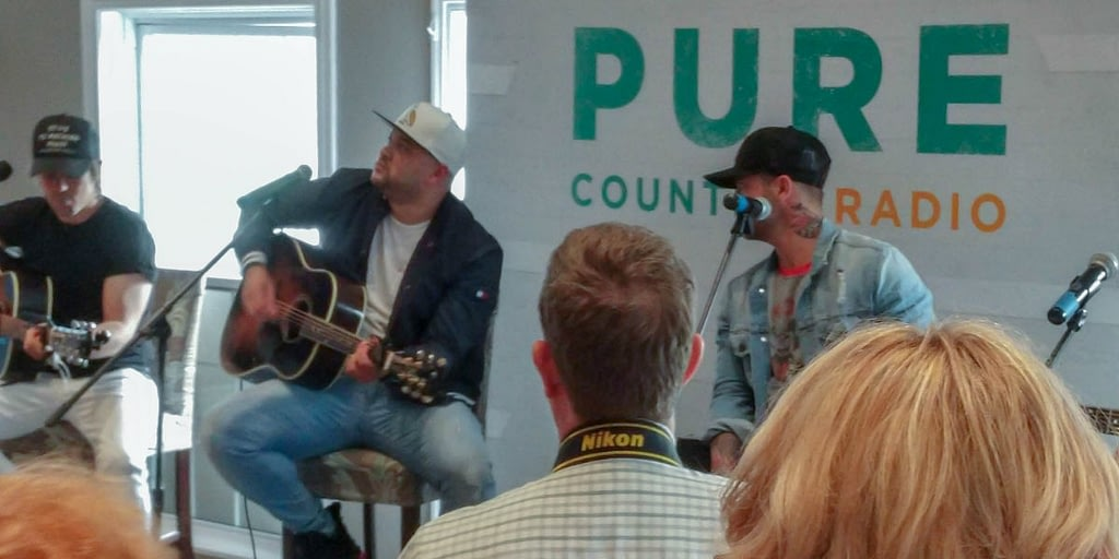 Tebey and Dallas Smith performing acoustic songs at the Tebey Golf Classic