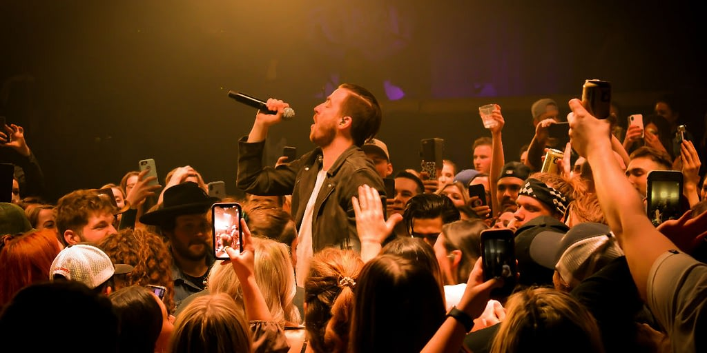Country band LANCO performing in the crowd at Edmonton's Ranch Roadhouse