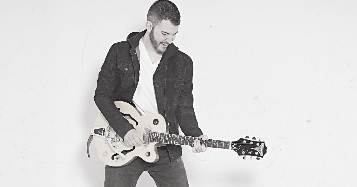 Steve Rivers Playing The Guitar