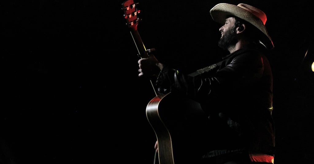 Dean Brody playing the guitar